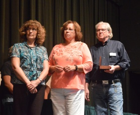 Retiring team members Tammy Doll, left, Lynn Gerstenkorn, and Bill McGlothing.