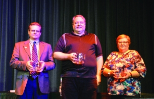 Dr. Todd Carter, Doug Browne, and Terri Barnes receive 25-year service awards.
