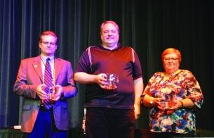 Dr. Todd Carter, Doug Browne, and Terri Barnes receive 25-year service awards.