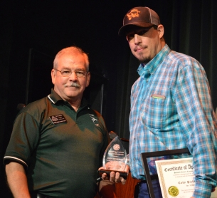 Instructor Cody Pickering receives an award from the Cimarron Valley Veterans and First Responders group, in recognition of his many years of work as a volunteer. SCCC Director of Admissions Bert Luallen, left, did the honors.